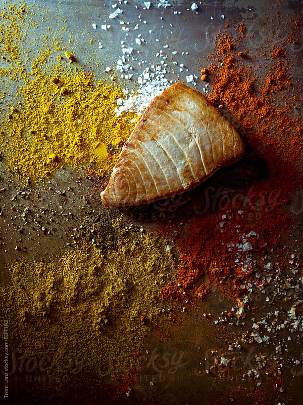 Curried Tuna Steaks with colorful spice by Trent Lanz for Stocksy United