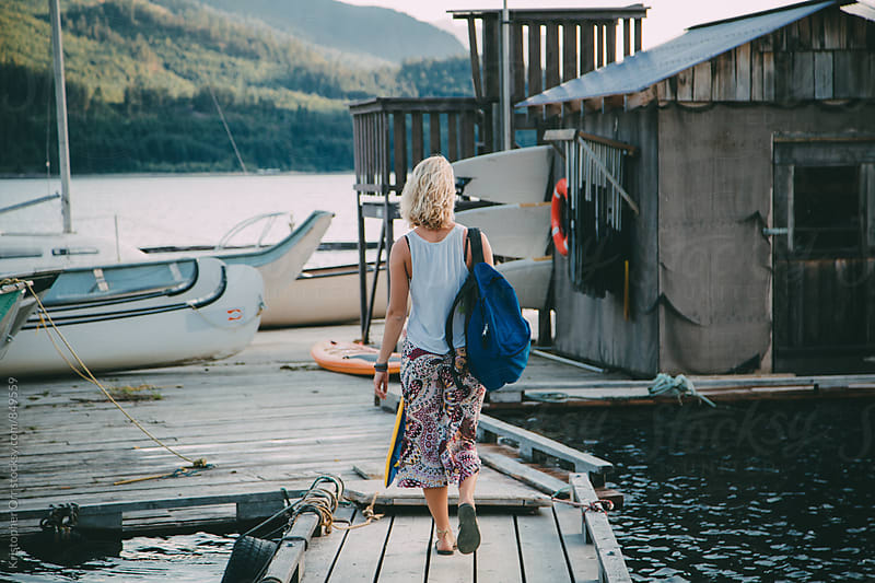 Woman Preparing for Sailing by Kristopher Orr for Stocksy United