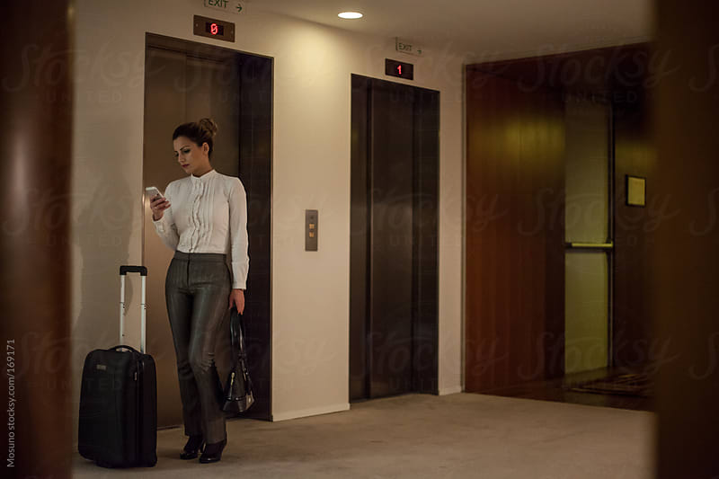 Businesswoman Standing by the Elevator by Mosuno for Stocksy United