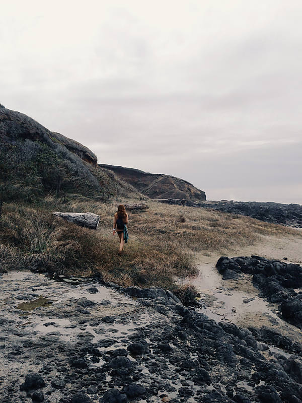 Woman Exploring Rugged Coastline by Kevin Russ for Stocksy United