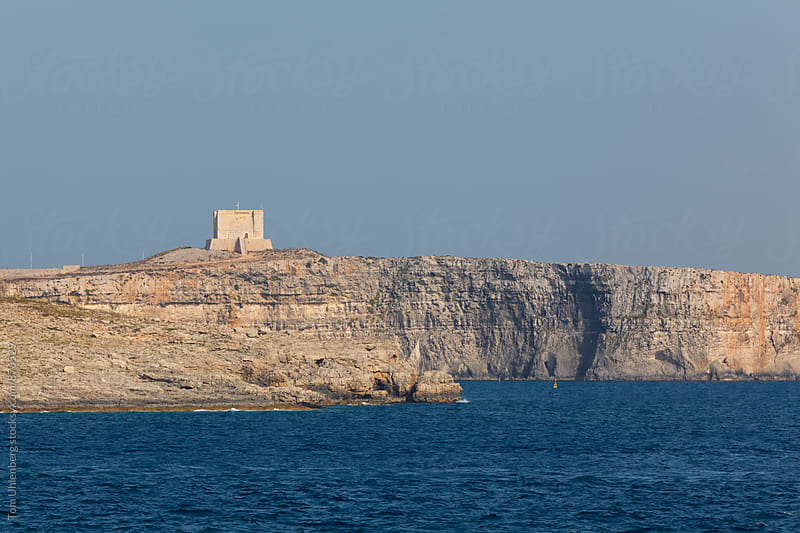 Comino, Malta - Limestone Cliff with a Watchtower on the Maltese Coast by Tom Uhlenberg for Stocksy United