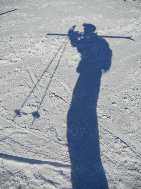 Shadow of unrecognizable skier on snow by rolfo for Stocksy United