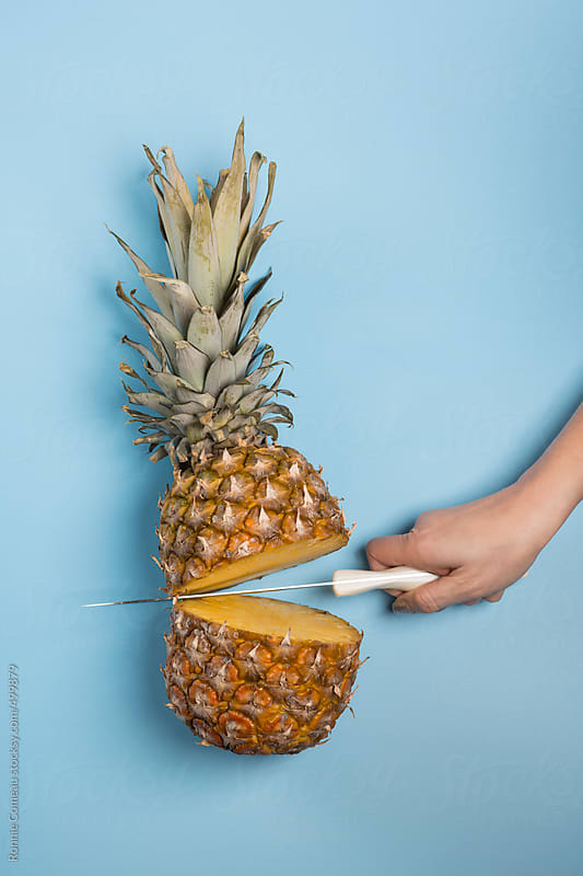 Pineapple In The Moment Right After It Has Been Chopped by Ronnie Comeau for Stocksy United