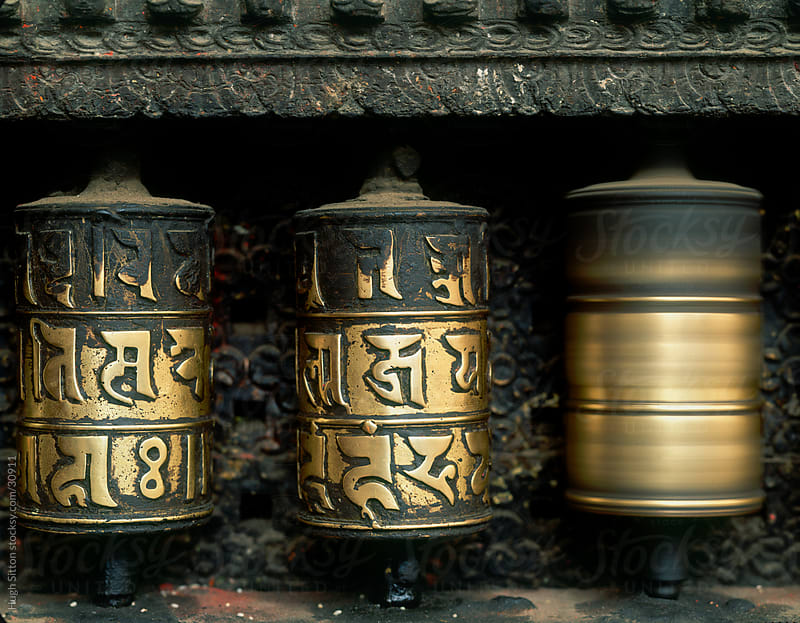 Prayer wheels at Swayambhunath Temple. Kathmandu. by Hugh Sitton for Stocksy United