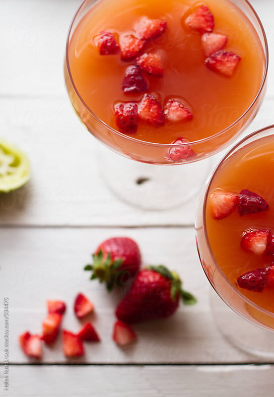 Strawberry and rhubarb margaritas by Helen Rushbrook for Stocksy United