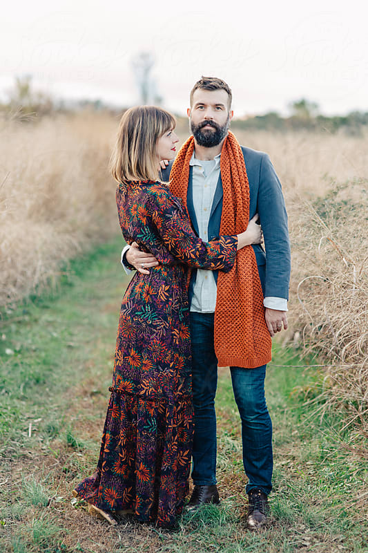 A beautiful and stylish couple standing by a field by Jakob for Stocksy United
