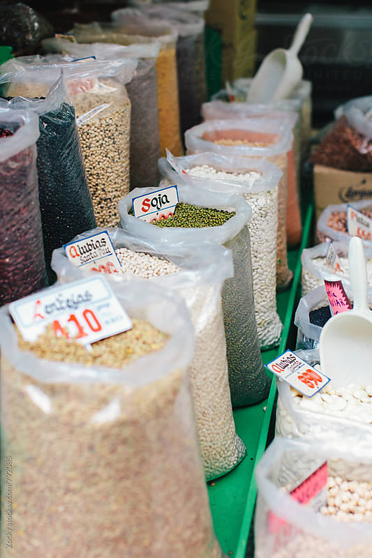 Corn, soybeans, beans, ground corn in bags at the market by Zocky for Stocksy United