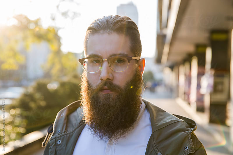 Portrait of handsome hipster man with a beard by Jovo Jovanovic for Stocksy United