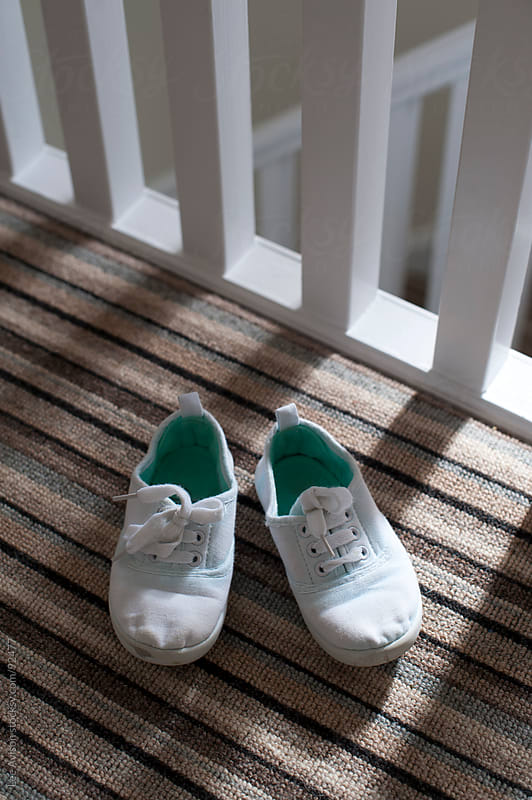 childs shoes on the landing by Lee Avison for Stocksy United