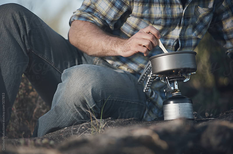 camping stove man by Daxiao Productions for Stocksy United