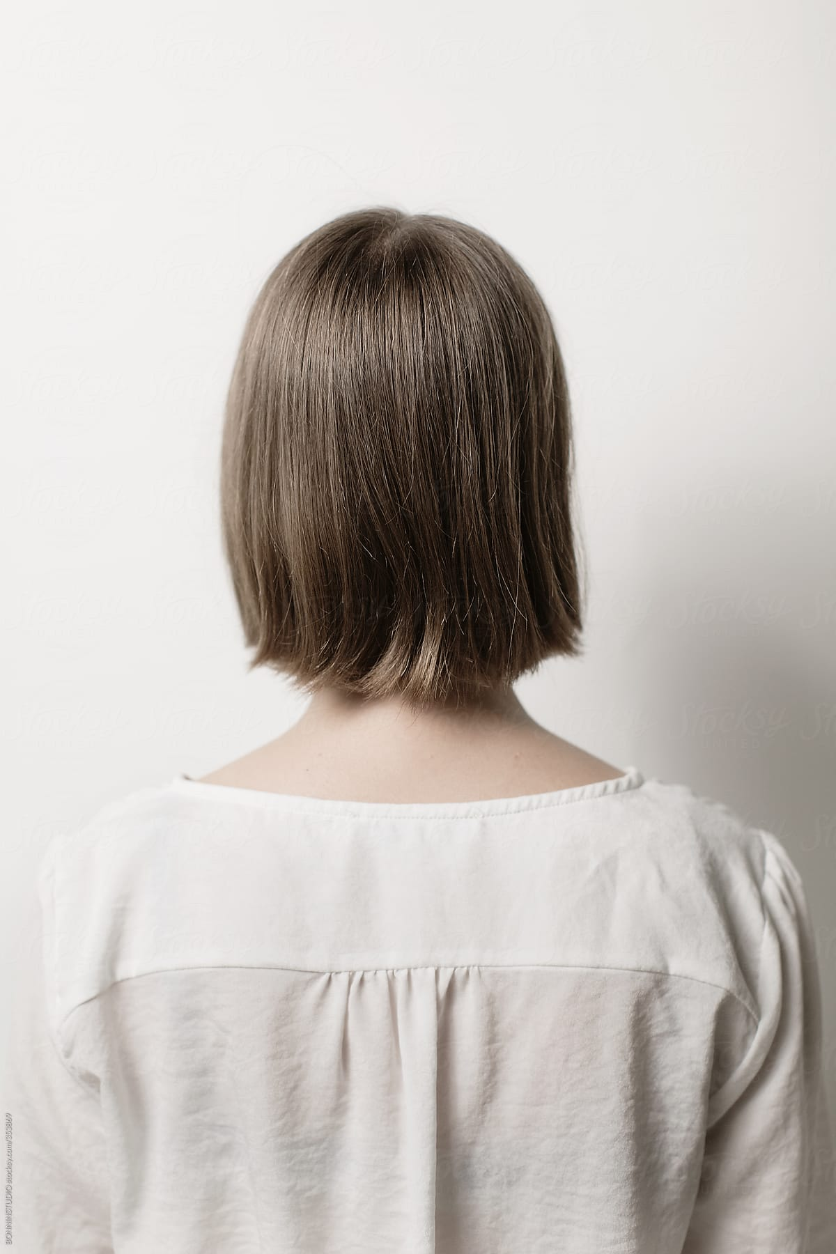 Back View Of Young Woman With Short Hair Over White Background By Bonninstudio Stocksy United