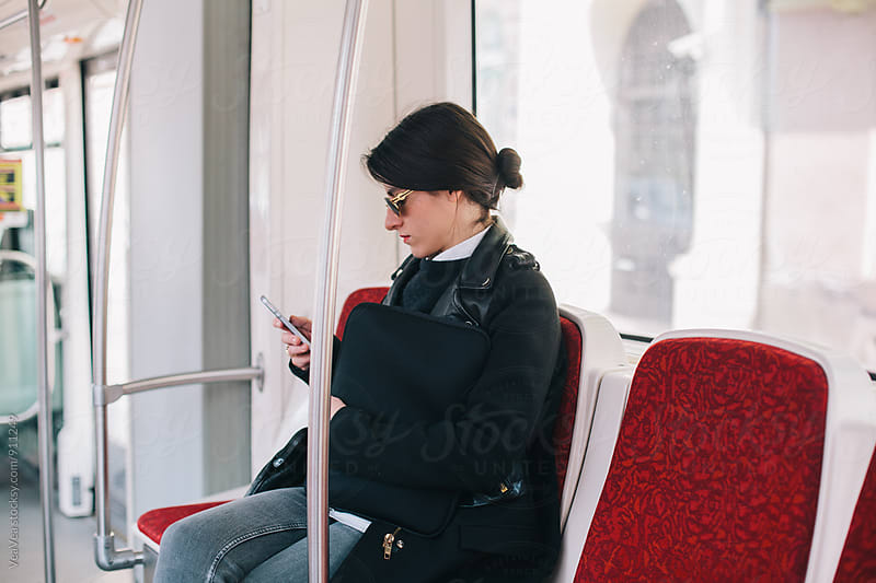 Woman taking a tram by Marija Mandic for Stocksy United