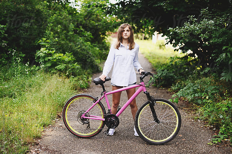 Girl and bicycle by Sveta SH for Stocksy United