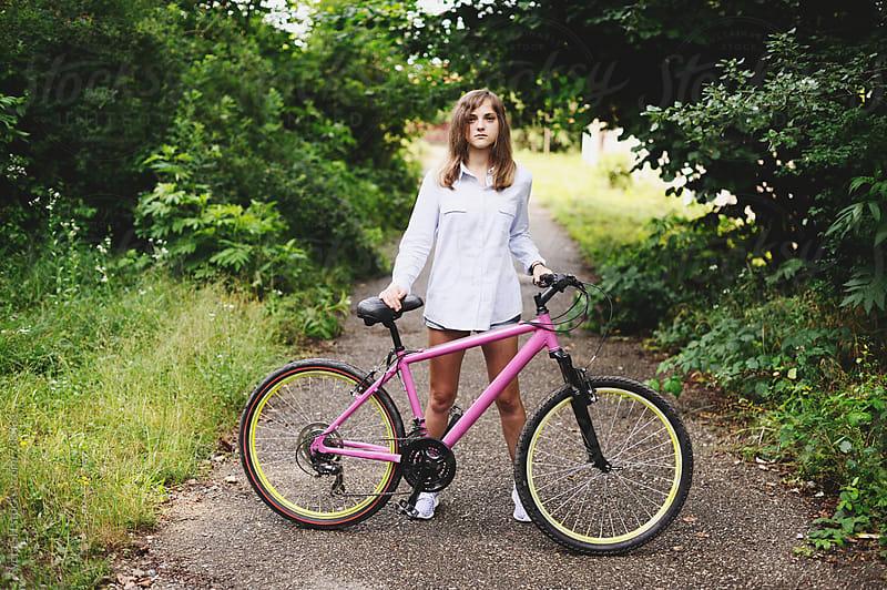 Girl and bicycle by Svetlana Shchemeleva for Stocksy United
