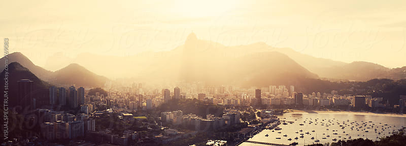 Rio de Janeiro Skyline With Christ the Redeemer in Yellow Afternoon Light by Julien L. Balmer for Stocksy United