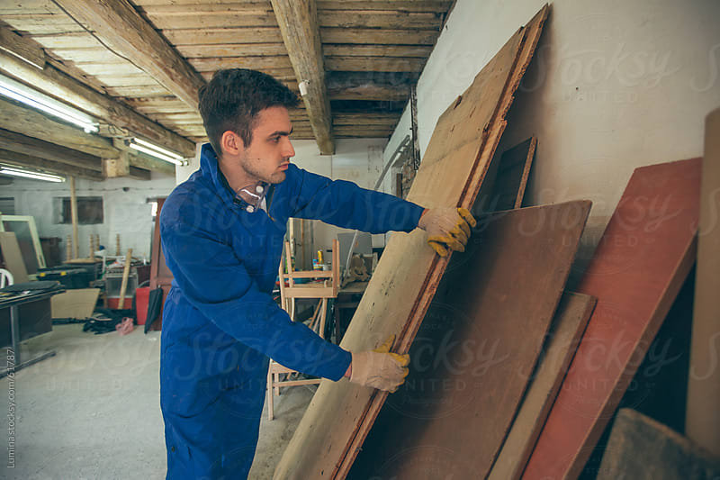 Carpenter Holding a Wooden Panel by Lumina for Stocksy United