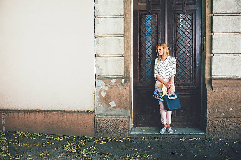 Woman Standing by the Old Door by Lumina for Stocksy United