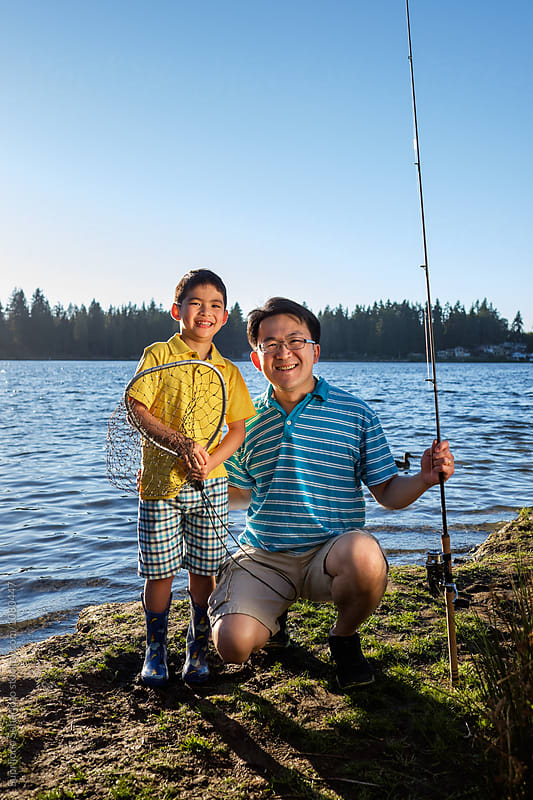 Happy Asian father and his son going on a fishing trip to the lake by Suprijono Suharjoto for Stocksy United