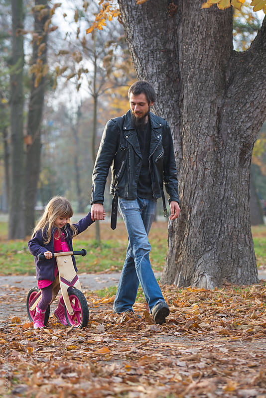 Rocker dad with his little girl  by RG&B Images for Stocksy United