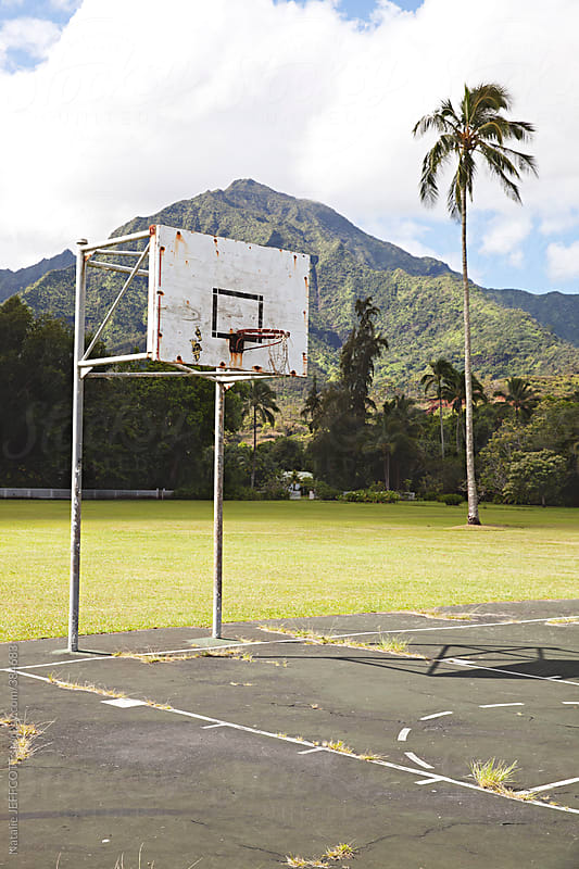 Outdoor basketball court in Hanalei Hawaii by Natalie JEFFCOTT for Stocksy United