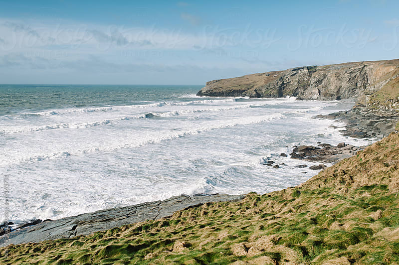 View from a cliff out to sea  by Suzi Marshall for Stocksy United