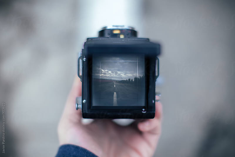 vintage camera in the hands by Javier Pardina for Stocksy United