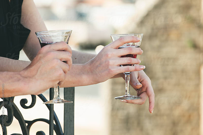 Close up of beautiful couple drinking wine on the rooftop. by BONNINSTUDIO for Stocksy United
