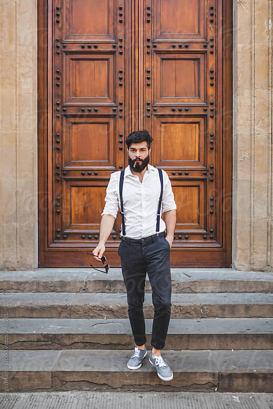 Tough Italian Man in front of an Old Wooden Door by Giorgio Magini for Stocksy United