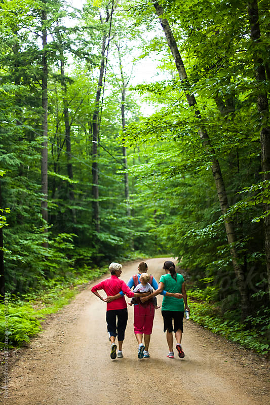 Family Walk on Summer vacation in Rural New Hampshire, USA by Raymond Forbes LLC for Stocksy United