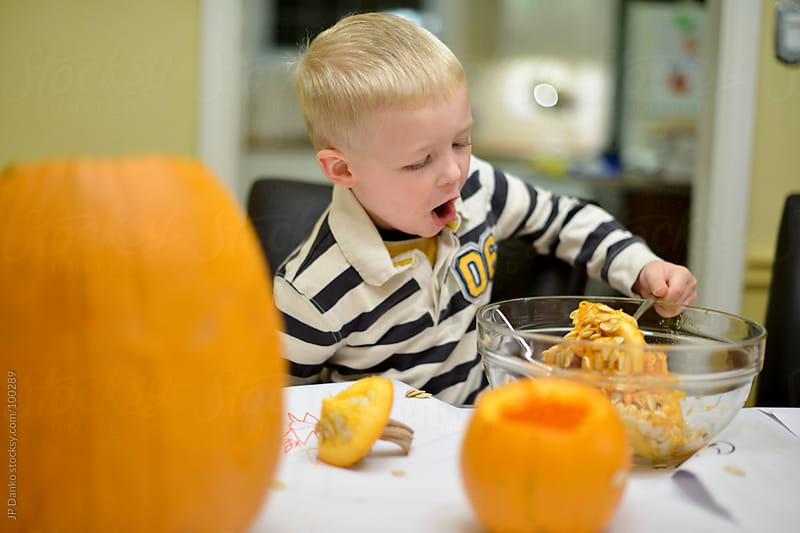 Halloween Orange Pumpkin Carving With Pumpkin Seeds by JP Danko for Stocksy United