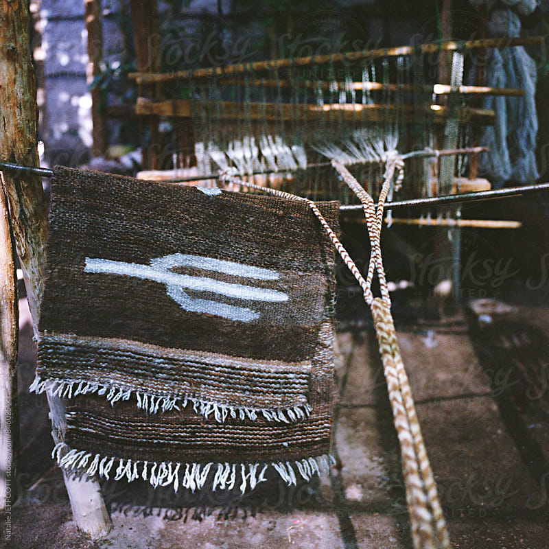 Hand woven woolen rug with cactus design on old fashioned loom in Chile by Natalie JEFFCOTT for Stocksy United