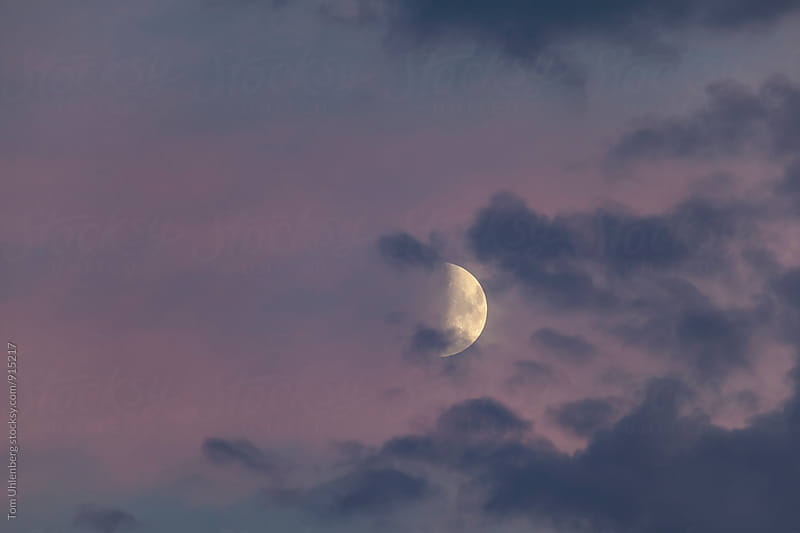 Half Moon and Cloudy Evening Sky by Tom Uhlenberg for Stocksy United