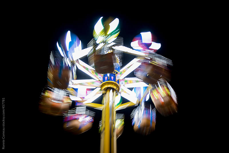 Twirling Amusement Park Ride by Ronnie Comeau for Stocksy United