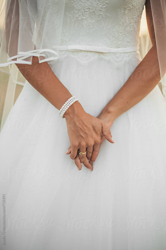 Hands of Beautiful Woman Wearing Wedding Dress. by Studio Firma for Stocksy United