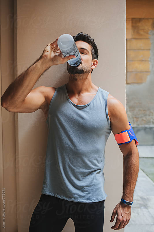 Athlete Drink Water During a Workout by Lumina for Stocksy United