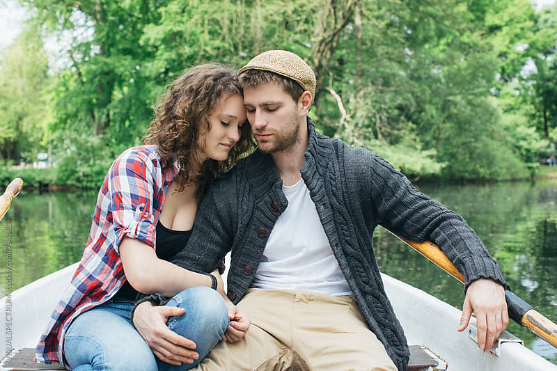 Portrait of Young Caucasian Couple Hugging in Rowboat by VISUALSPECTRUM for Stocksy United