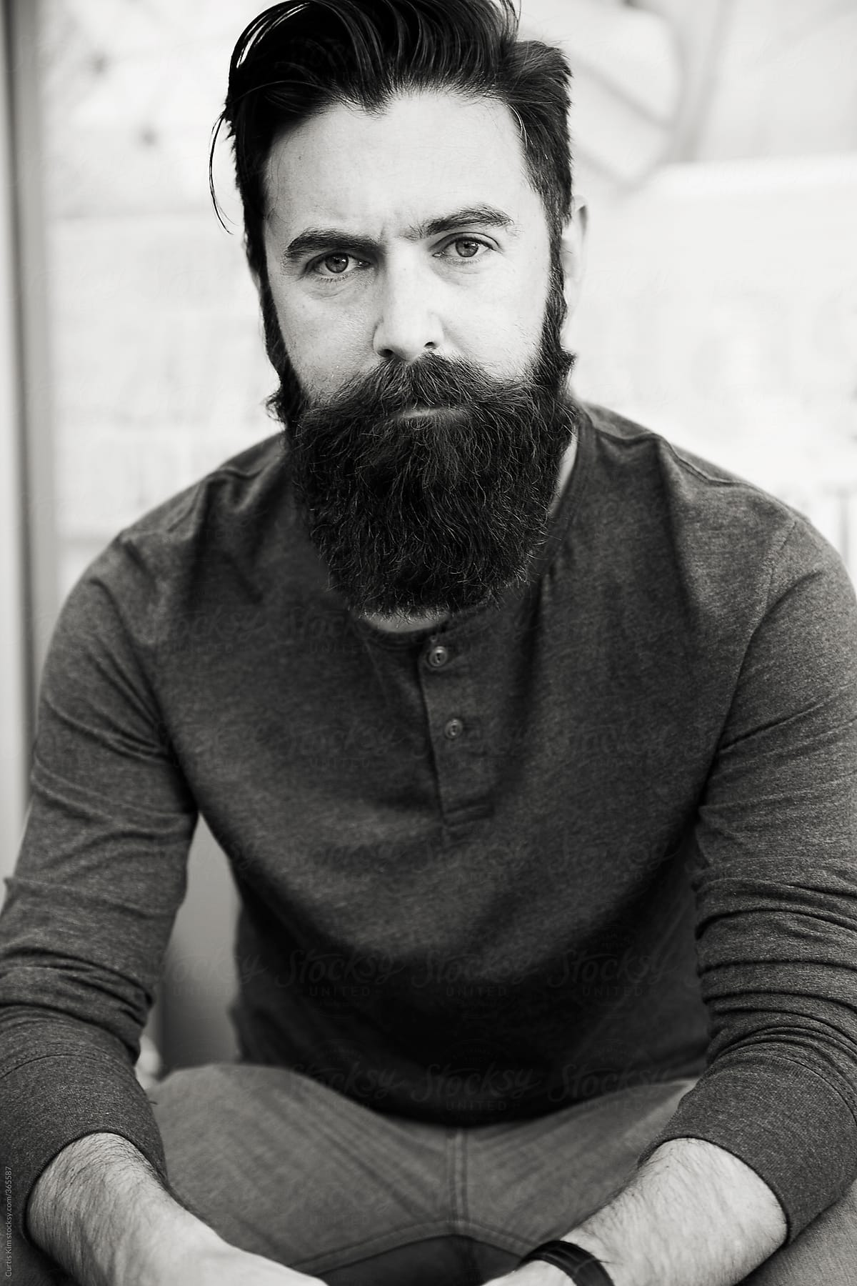 Phenomenal Handsome Male Model With Beard Sitting And Looking By Curtis Kim Natural Hairstyles Runnerswayorg