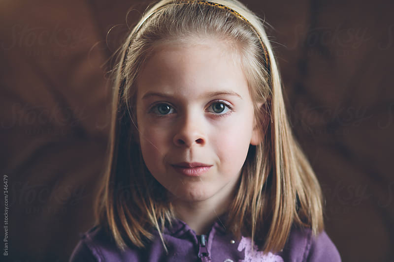 closeup of young girl's face by Brian Powell for Stocksy United