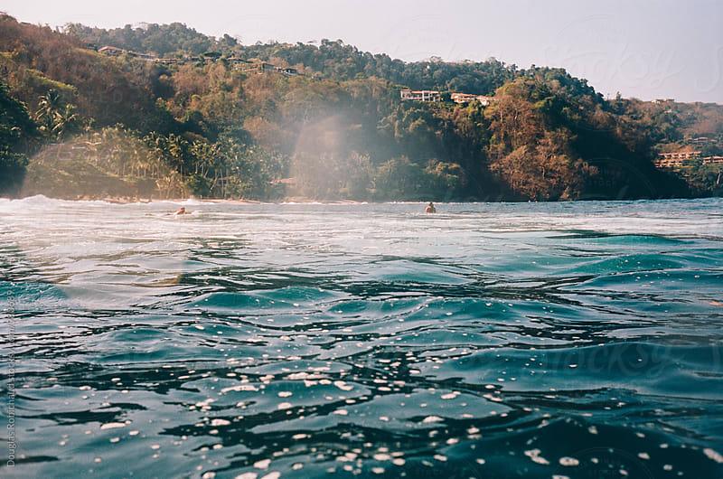 Reef break surf spot by Douglas Robichaud for Stocksy United