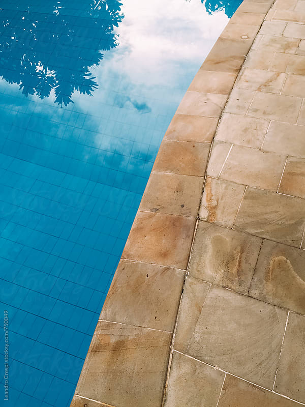 Reflections in the water of a swimming pool by Leandro Crespi for Stocksy United