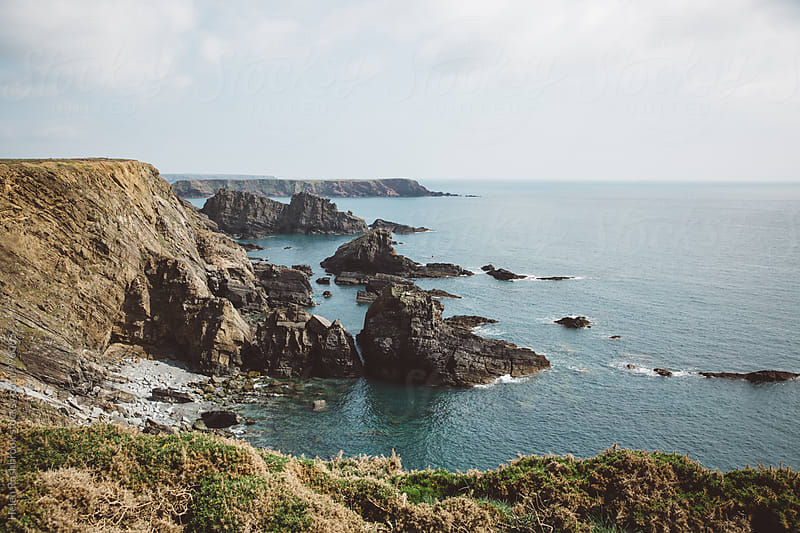 Dramatic and beautiful coastline of West Wales, UK. by Helen Rushbrook for Stocksy United