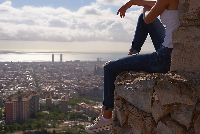detail of female legs with barcelona on Background by Guille Faingold for Stocksy United