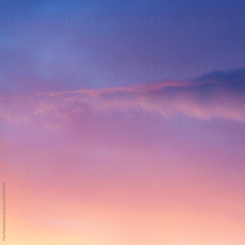 Pink and purple clouds at dawn, Utah by Paul Edmondson for Stocksy United