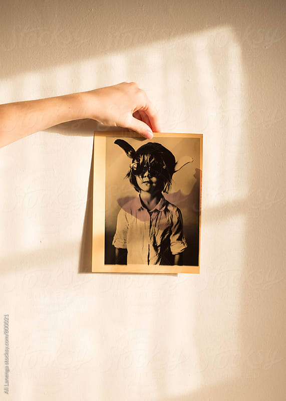 Holding a photograph by Ali Lanenga for Stocksy United
