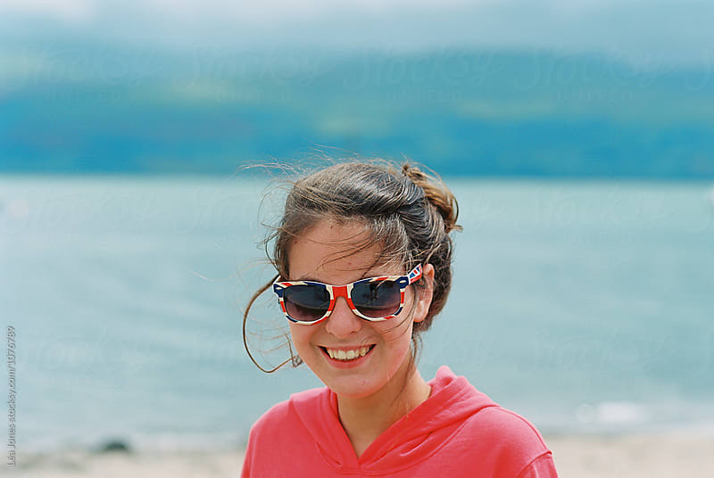 young woman with union jack sunglasses by Léa Jones for Stocksy United