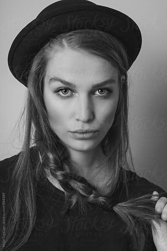 Young beautiful woman in studio by Maja Topcagic for Stocksy United