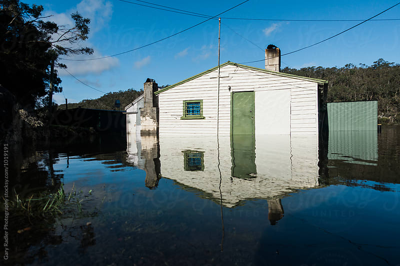 Cottage in a Flooded River by Gary Radler Photography for Stocksy United