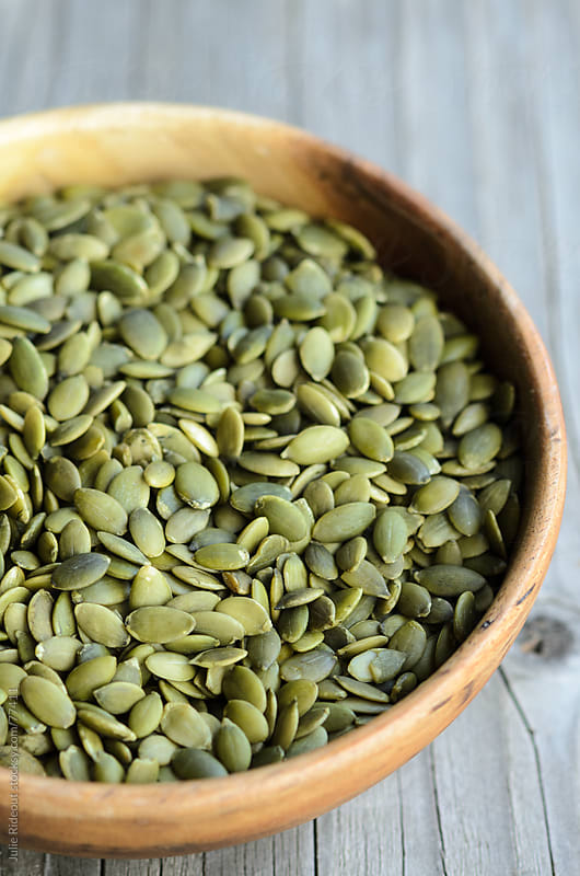 Raw Pumpkin Seeds (Pepitas) by Julie Rideout for Stocksy United