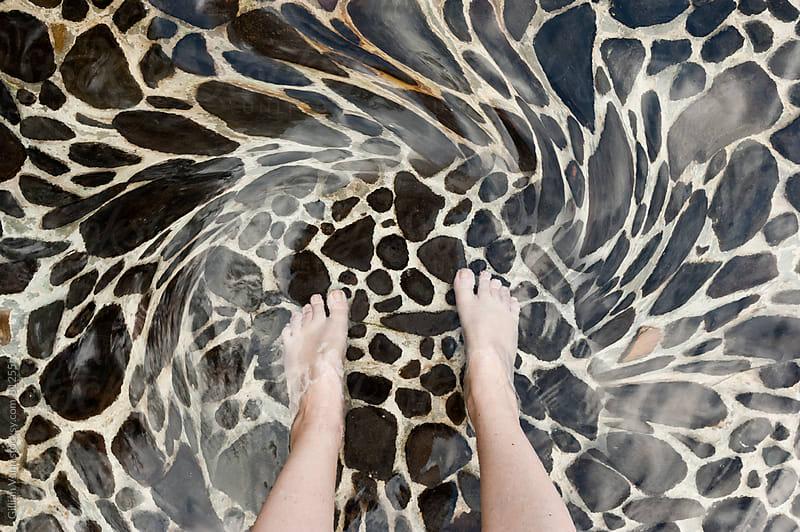 feet in water by Gillian Vann for Stocksy United