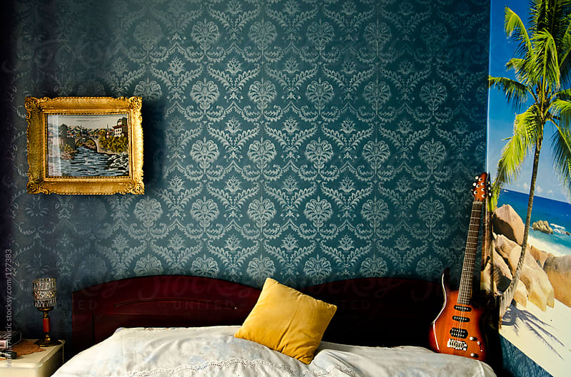 Electric guitar in retro vintage room by Marija Anicic for Stocksy United